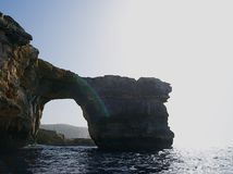 Azure  Window and the grotto ,famous limestone arch. Visiting with boats amazing Azure  Window and the grotto ,famous limestone arch in UNESCO Heritage Site Stock Photos