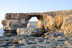 Azure Window. The last sun waves touching the Azure Window in Malta Stock Images