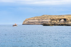 The Azure Window is a limestone natural arch on the Maltese isla. The Azure Window is Gozo's iconic flat-topped natural rock arch over the sea at Dwejra Royalty Free Stock Images