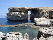 Azure window in Malta. Natural stone arch Azure Window and Mediterranean coastline on Gozo Island, Malta Stock Photography