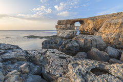 Azure Window Malta. View of the Azure Window, a natural arched rock in Dwejra, Gozo, Malta. Captured around sunset Royalty Free Stock Photo