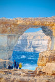 On the cliffs of now collapsed Azur Window, Gozo, Malta. The Azure Window was a 28-metre-tall limestone natural arch on the island of Gozo in Malta, collapsed Royalty Free Stock Image