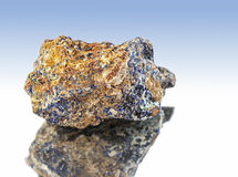 Azurite. Isolated, close-up, on a blue gradient background royalty free stock photos