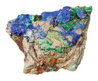 Azurite and Malachite on raw stone isolated. Macro shooting of natural mineral rock specimen - blue Azurite and green Malachite on raw stone isolated on white stock photography
