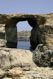 Azurre Window. Huge rock formations at Dwejra, Gozo, Malta. This naturally cut window is better known as the Azure Window Royalty Free Stock Photo