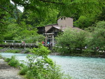 Azusa river and bridge in Kamikochi. Kappa-bashi wooden bridge is the busiest spot in Kamikochi Royalty Free Stock Images