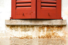 Azzate window  varese italy   brick red Royalty Free Stock Images