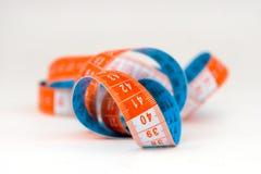 Azzurro e nastro di misurazione arancione Fotografia Stock