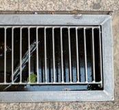 Bâche de grille, carter de vidange de précipitation exceptionelle d'égout Photographie stock libre de droits