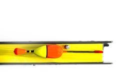 Bâti de pêche de Rod avec du liège, le crochet et l'avance d'isolement sur le blanc Photo libre de droits