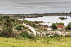 Bâtiment de pierres sèches dans Connemara, Galway Photos stock