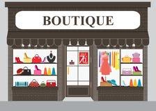 Bâtiment et intérieur de magasin d'habillement avec des produits sur des étagères Photos libres de droits