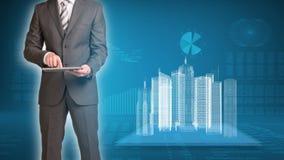 Bâtiments d'homme d'affaires et de fil-cadre dessus Photo stock