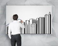 Bâtiments de dessin d'homme d'affaires Photographie stock