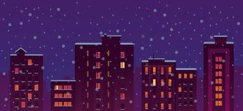 Bâtiments plats de nuit de neige de ville Photos libres de droits
