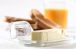 Bâton de beurre au déjeuner photographie stock