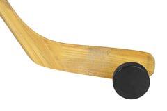 Bâton de hockey et galet image stock