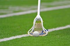 Bâton de Lacrosse de garçons image libre de droits