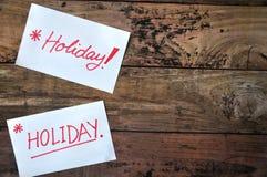 Bâton de note de vacances sur le conseil en bois Images libres de droits