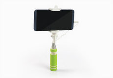 Bâton de Selfie avec le téléphone portable sur le fond blanc Images stock