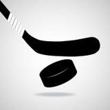 Bâton et galet d'hockey Photographie stock