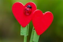 Bâton rouge en bois de forme de coeur Images stock