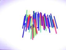 Bâtons colorés d'abrégé sur en gros plan paysage d'isolement sur le fond blanc Image stock