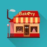 Bäckereigebäude mit Kuchen, Schaumgummiringen und Torten Stockfoto