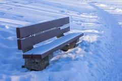 Bänk i vinter Arkivfoto