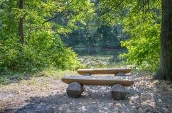 Bänk på kusten av sjön Fotografering för Bildbyråer