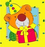 Bär, der ein Geschenk darstellt Lizenzfreie Stockbilder