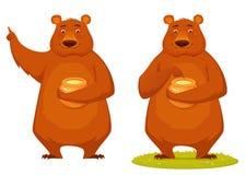 Bär, der Honigglas hält Stockfotografie
