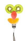 Bär frukt den roliga framsidan på en gaffel Arkivbild