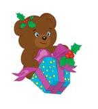Bär mit einem Geschenk für neues Jahr. Stockfotos