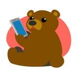 Bär mit einer Tablette Stockbild