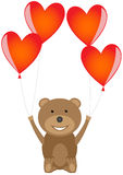 Bär mit roten Herzballonen Lizenzfreies Stockbild