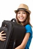 Bära ett bagage Arkivfoto