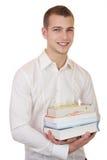 Bärande böcker för ung affärsman Arkivfoto