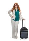 Bärande bagage för affärskvinna Arkivfoto