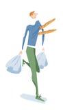 Bärande bagetter för gladlynt man och shoppingpåsar Arkivbilder