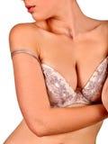 Bärande behå för flicka som undersöker deras bröst Fotografering för Bildbyråer