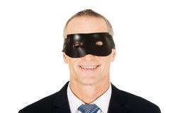 Bärande blåtiramaskering för affärsman royaltyfria foton