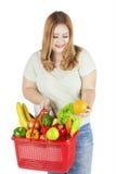 Bärande grönsak för fet kvinna Fotografering för Bildbyråer