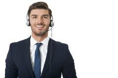 Bärande hörlurar med mikrofon för man med stereo- hörlurar royaltyfri bild