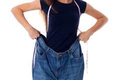 Bärande jeans för kvinna av mycket större format royaltyfria bilder