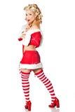 Bärande juldräkt för sexig blond kvinna på vit bakgrund Royaltyfria Bilder