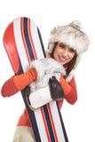 Bärande vinterdräkt för modell som rymmer en snowboard Royaltyfria Foton