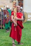 Bärare av romarepajassymboler i en demonstration royaltyfria foton