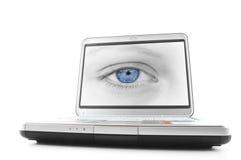 bärbar dator för blått öga arkivbild