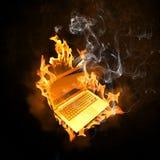Bärbar dator i brandflammor Fotografering för Bildbyråer